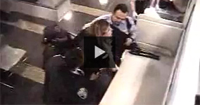 Police Beating Up a Woman at The Airport