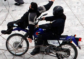Police Ran Over a Protester With a Bike
