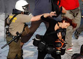 Photographer Pounched by a Police Officer