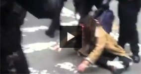 NYPD Cop Manhandles a Girl Protester During Arrest